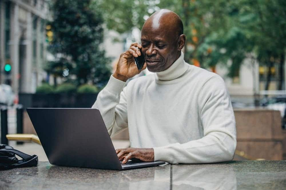 A man is using a laptop